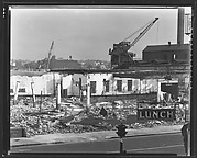 "[Demolition Site with Cranes and ""Lunch"" Sign in Foreground, New York City]"