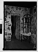 [Interior with Newspaper-Covered Walls and Wicker Mirror Stand, Hale County?, Alabama]