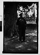 [Man Wearing Cap and Overalls Standing Next to Tree, Hale County?, Alabama]