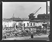 """[Demolition Site with Cranes and """"Lunch"""" Sign in Foreground, New York City]"""