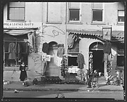 [Shoe and Clothing Storefront with Pedestrians on Sidewalk, Savannah, Georgia]