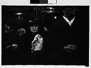 [Subway Passengers, New York City: Elderly Woman Clutching Paper Bag, Seated Between Man and Woman]