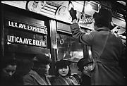 "[Subway Passengers, New York City: Women Beneath ""Lex Ave Express"" Sign and Standee]"