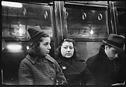 [Subway Passengers, New York City: Two Young Women, Man]