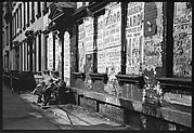 [View Down Street in Hell's Kitchen with Children on Stoop and Torn Circus Posters, New York City]