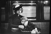 [Subway Passengers, New York City: Woman in Velvet Collar with Arm Around Child]