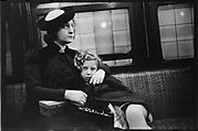 [Subway Passengers, New York City: Woman in Velvet Collar with Arm Around Child]