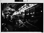 [Subway Passengers, New York City: Woman in Polkadot Dress Reading and Two Little Girls in Bonnets]