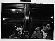 [Subway Passengers, New York City: Two Women in Conversation Beneath