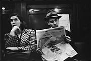 [Subway Passengers, New York City: Woman, Man in Hat Reading Newspaper]