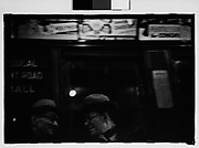 [Subway Passengers, New York City: Cut Fragment of 35mm Film Frame of Woman in Front of Transit Authority Poster]