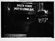 "[Subway Passenger, New York City: Man in Hat and Overcoat Beneath ""South Ferry"" Sign]"