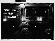 """[Subway Passengers, New York City: Man in Cap, Woman in Hat and Gloves Beneath """"7th Ave Local"""" Sign]"""