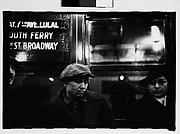 "[Subway Passengers, New York City: Sleeping Man in Cap, Woman in Hat and Gloves Beneath ""7th Ave Local"" Sign]"