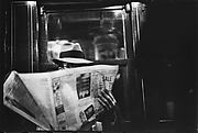 [Subway Passenger, New York City: Man Reading Newspaper]