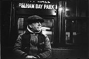 "[Subway Passenger, New York City: Man in Cap Beneath ""Pelham Bay Park"" Sign]"