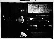 [Subway Passenger, New York City: Man in Hat Beneath Map]