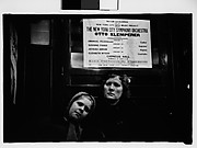 [Subway Passengers, New York City: Mother and Daughter Beneath Symphony Poster]