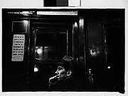 [Subway Passenger, New York City: Left Profile of Man in Hat]