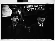 "[Subway Passengers, New York City: Two Men Beneath ""Pelham Bay Park"" Sign]"