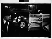[Subway Passengers, New York City: Couple with Child, Woman Reading Newspaper]