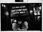 "[Subway Passenger, New York City: Woman in Hat and Fur Collar Reading Beneath ""City Hall"" Sign]"