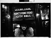 "[Subway Passenger, New York City: Woman in Hat and Fur Collar Beneath ""City Hall"" Sign]"