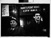 "[Subway Passengers, New York City: Two Men Beneath ""City Hall"" Sign]"