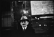 [Subway Passenger, New York City: Man in Hat]