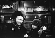 [Subway Passengers, New York City: Woman in Face-Veiled Hat and Boy on Times Square Shuttle (Blurred View)]