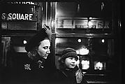 [Subway Passengers, New York City: Woman in Face-Veiled Hat and Boy on Times Square Shuttle]