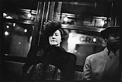 [Subway Passengers, New York City: Woman in Fur Hat and Coat, Man in Cap on Times Square Shuttle]