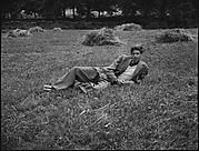 [Cass Canfield, Jr. Lying in Field, Bedford, New York]