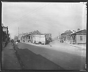 [Fork in Road with Two Rows of Wooden Houses and People on Corner, Savannah or Augusta, Georgia]
