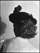[Anne Harvey Wearing Hat, From Behind]