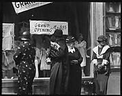 [Shoppers in Front of H.C.F. Koch & Co. Department Store Window, West 125th Street, New York City]