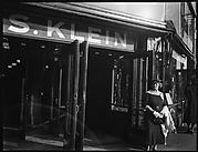 [Woman Outside Entrance of S. Klein-on-the-Square Department Store, Union Square East, New York City]