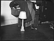 [Lamp on Floor and Trunk Draped with Clothes, Possibly New York City]