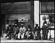 [Men Seated on Bench in Front of Post Office, Fort Motte, South Carolina]