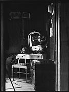 [Interior with Dressing Stand, Pictures, and Tie Rack, Near Hobe Sound, Florida]