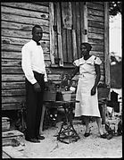 [Man in Bow Tie and Woman Outside House, Florida]