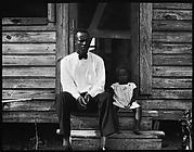 [Man Wearing Bow Tie and Young Girl Seated on Steps of House, Florida]