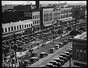 [Stores and Parked Cars on Main Street, From High Elevation, Macon, Georgia]