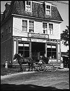 [Horse-Drawn Carriage in Front of General Store and Post Office, Plainfield, New Hampshire]