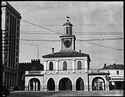 [Public Building with Clocktower and Ground Floor Colonnade]