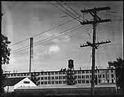 "[""LEE HATS"" Factory Building with Telephone Building in Foreground]"