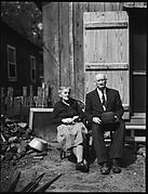 [Old Couple on Bench in Yard]
