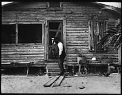 [Man Outside Wooden House, Florida]