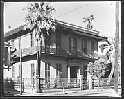 [Cast-Iron Balconied House on Corner with Stoplight in Foreground, New Orleans, Louisiana?]