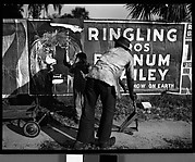 [Man and Child with Wagon in Front of Torn Circus Poster, Florida]